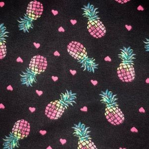 Black background w/pink, yellow & green pineapples